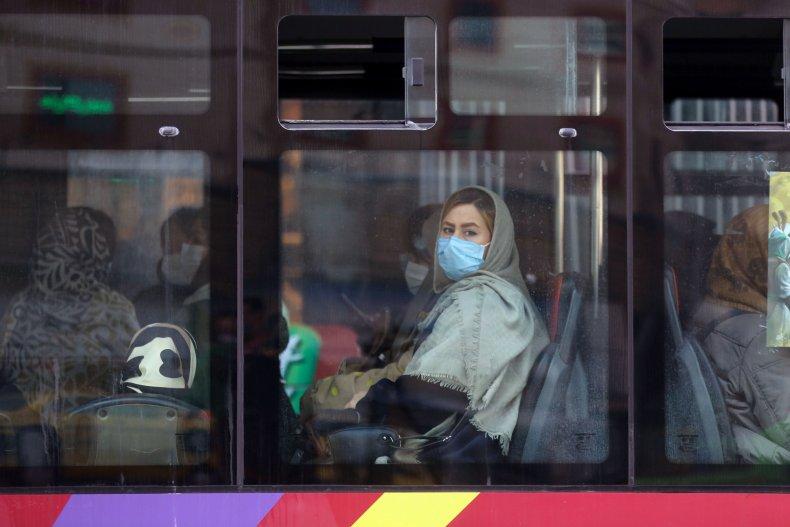 Iran woman on bus in Tehran mask