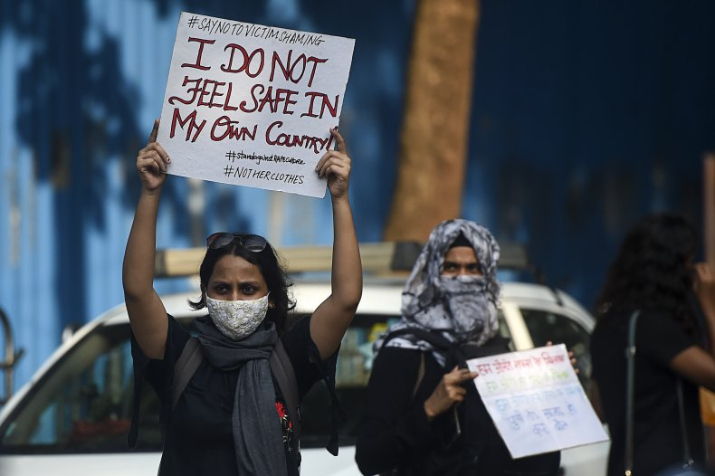 Activists hold placards during a Mumbai protest