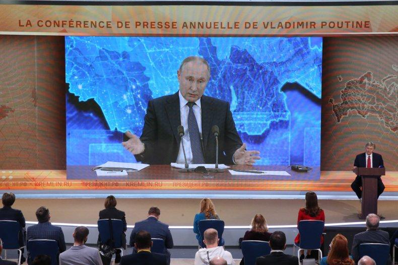 Vladimir Putin speaks during press conference