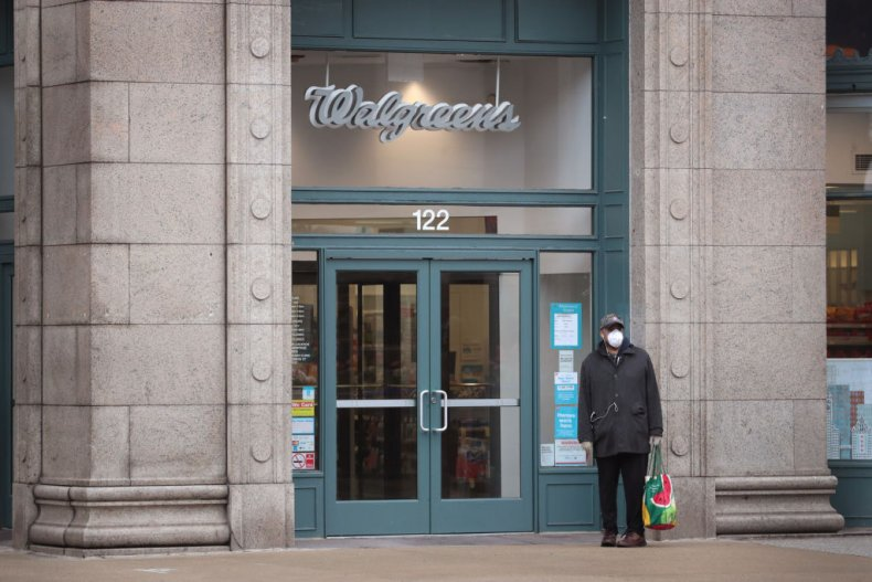 A man in a facemask outside Walgreens
