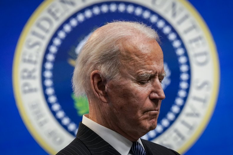 Joe Biden pictured after signing manufacturing EO