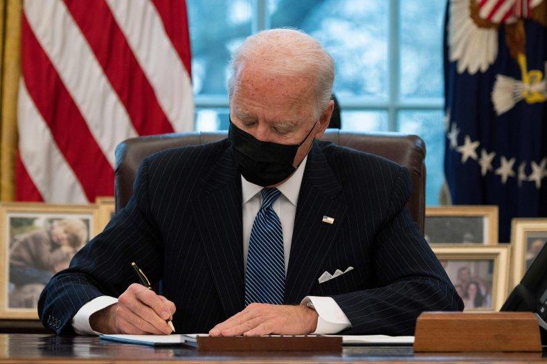 joe biden signs order reversing ban