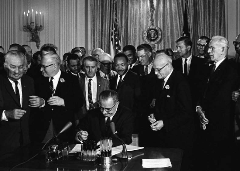 LBJ signs the Civil Rights Act