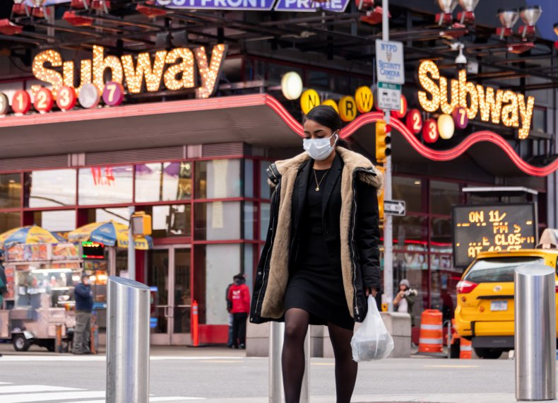 Person Wearing a Mask in Times Square