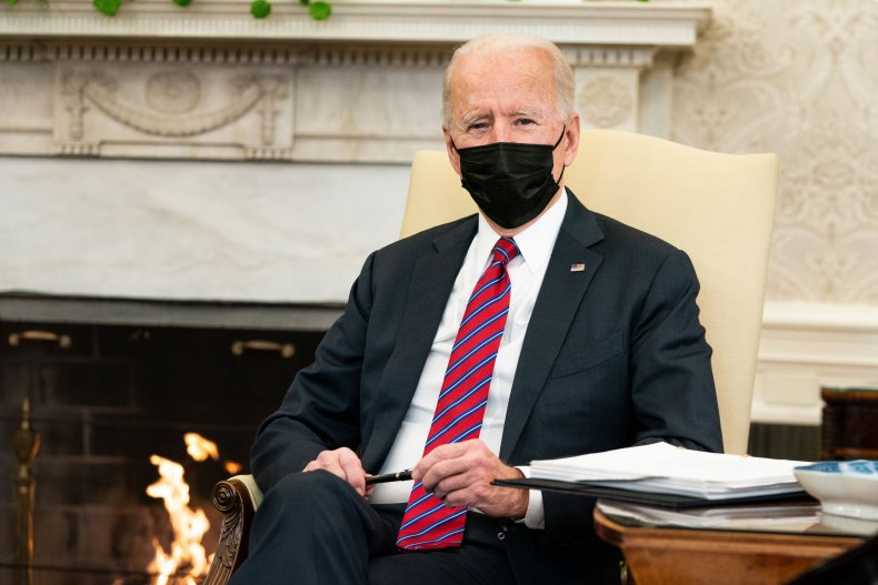 joe biden receiving briefing in oval office