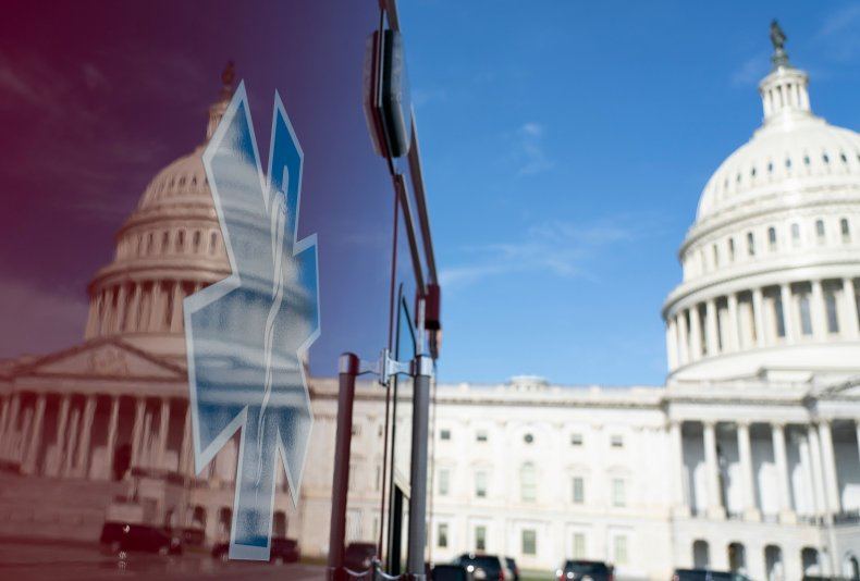 US Capitol reflected in ambulance stimulus talks