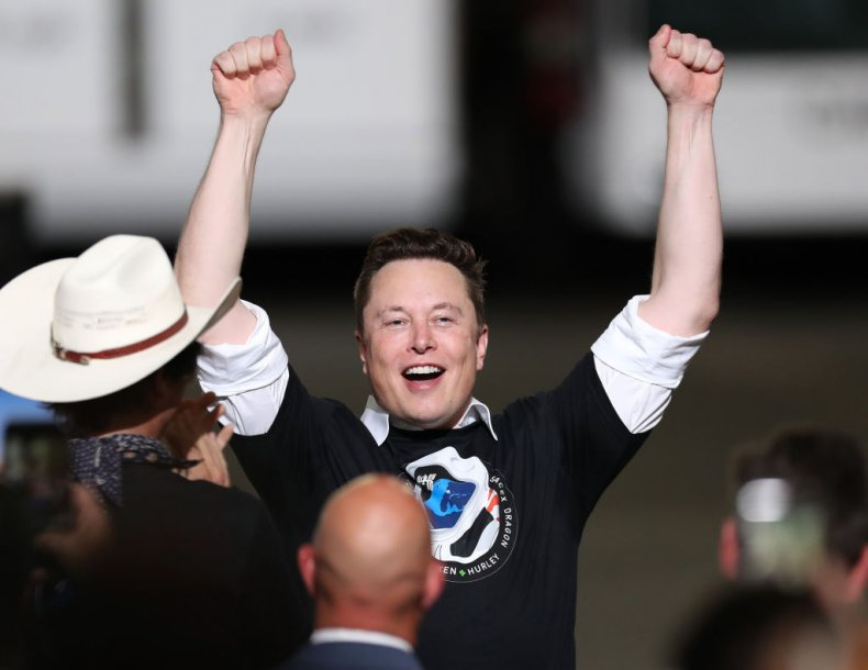 Elon Musk celebrating at a SpaceX launch