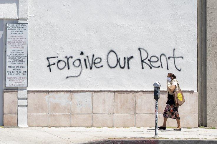 """Forgive our rent"" graffiti"