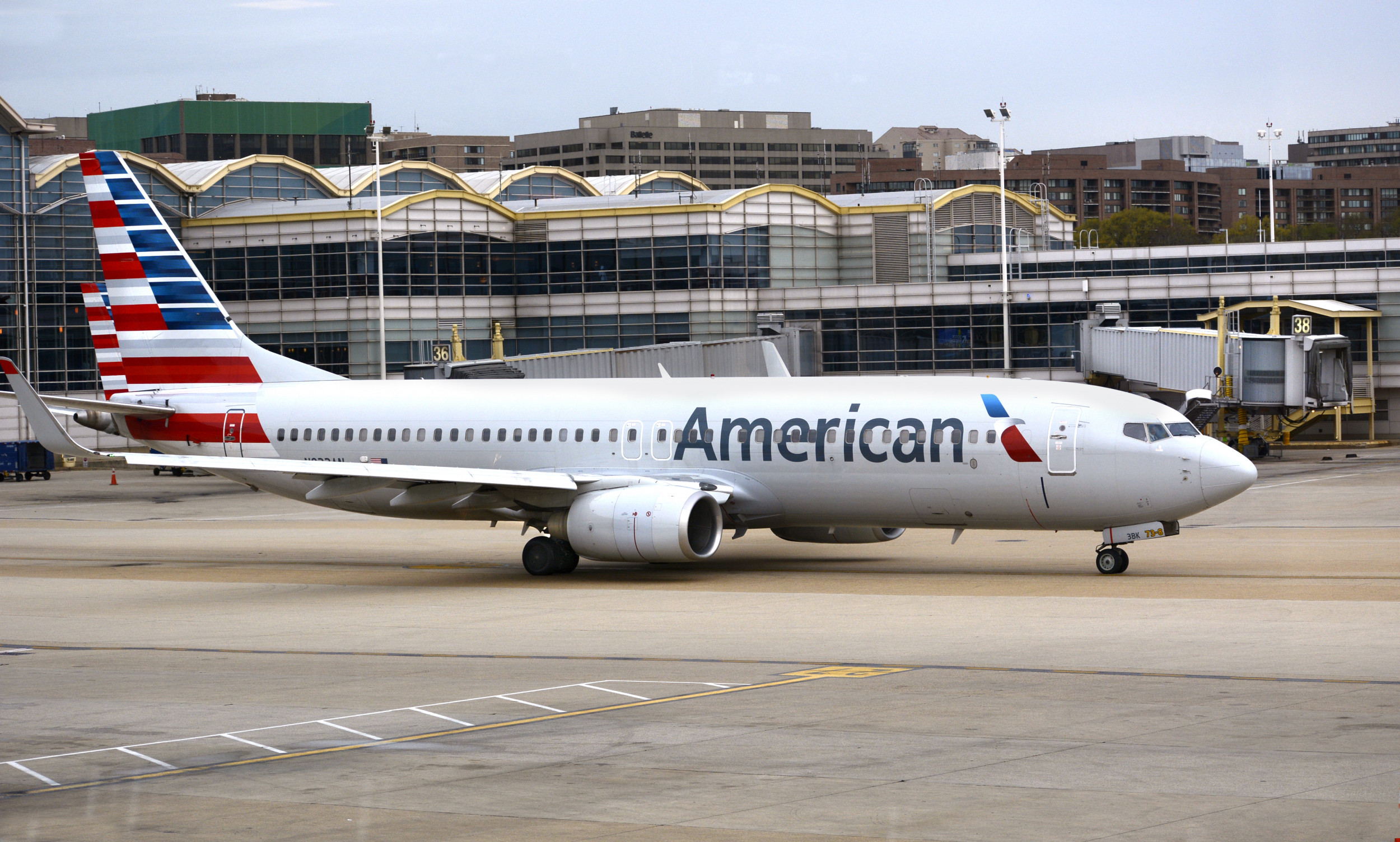 Woman Accused of Punching American Airlines Flight Attendant Over Garbage Is Given Travel Curbs