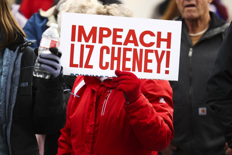 A Woman Holding an Impeach Cheney Sign