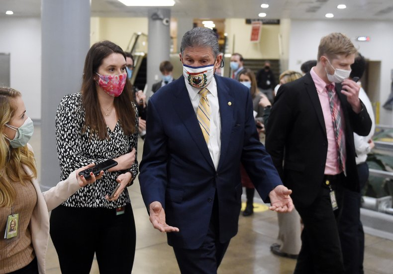 joe manchin answers questions from reporters