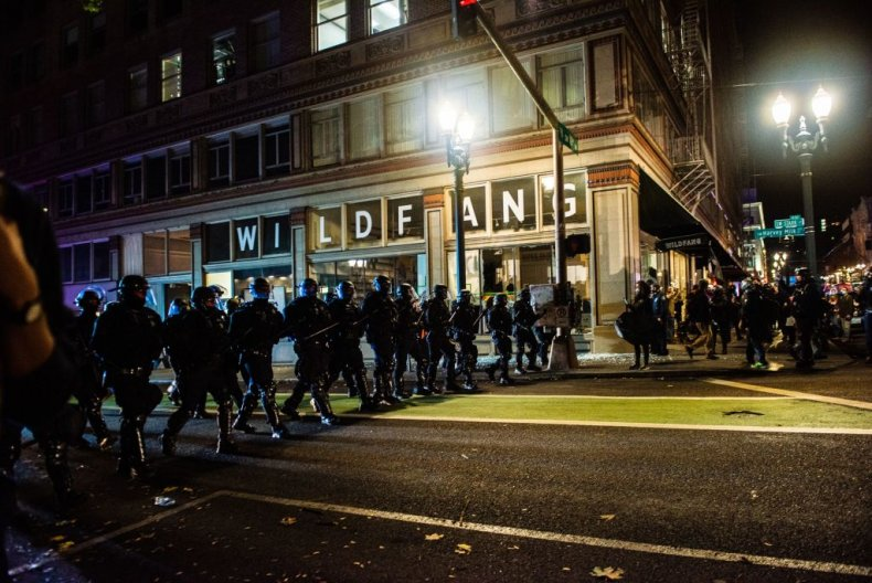 Riot police march