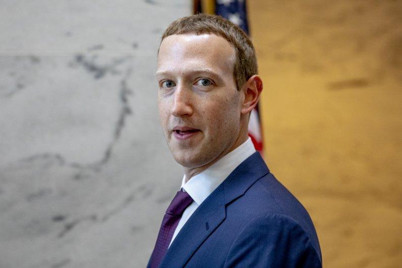 Mark Zuckerberg leaves a meeting with Senator