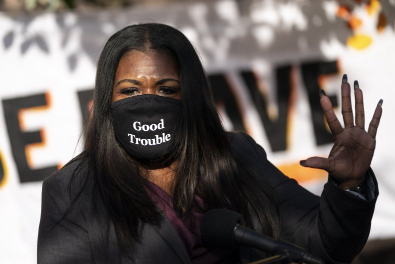 Representative Cori Bush wearing a face mask