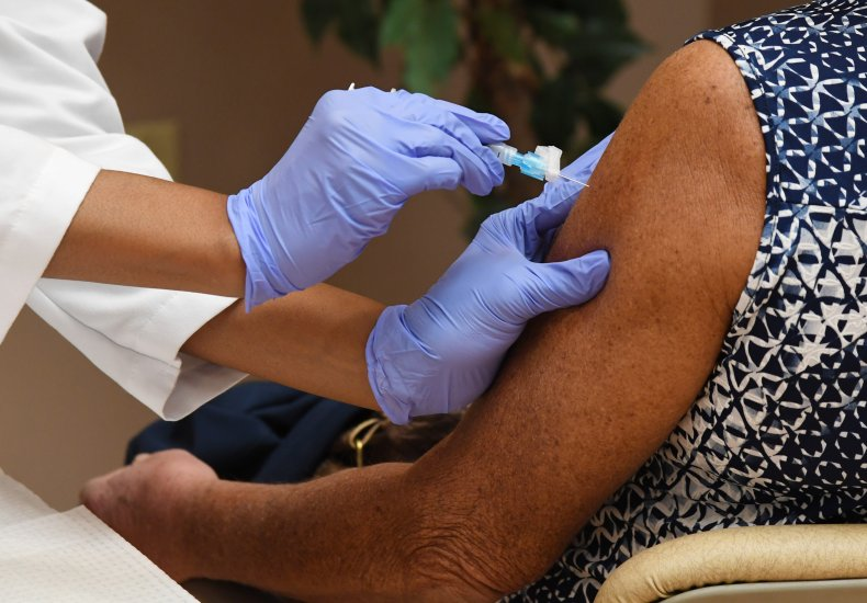 Health worker administers the Moderna COVID-19 vaccine