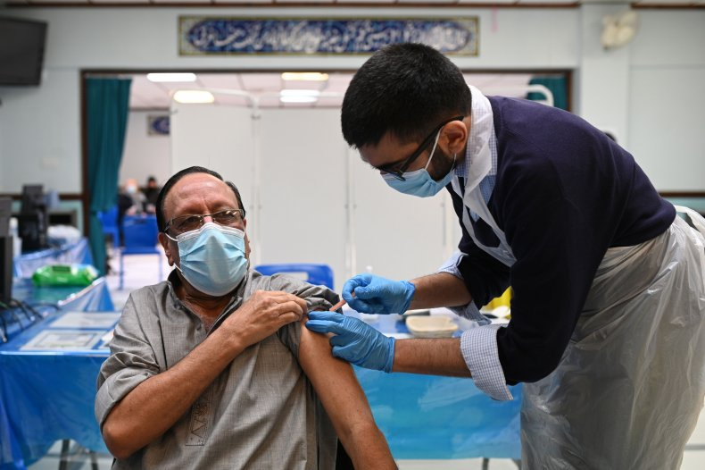 Health worker administers COVID-19 vaccine