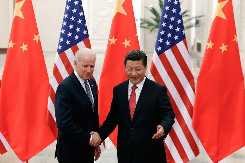 Biden and Xi Jinping shake hands