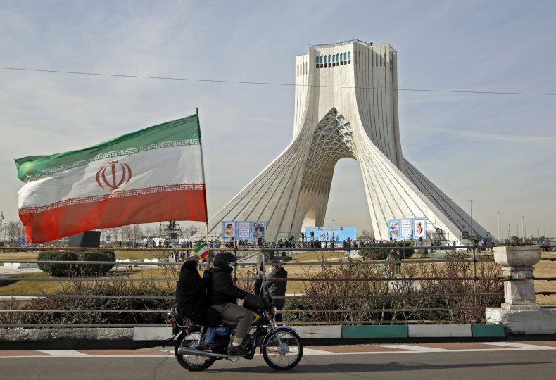 Iranians pictured in Tehran on national day