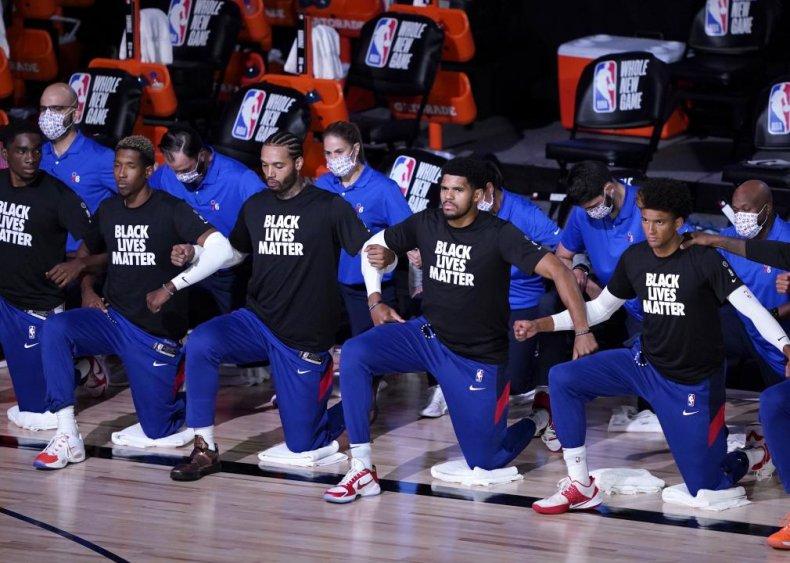 Philadelphia 76ers players kneel and protest