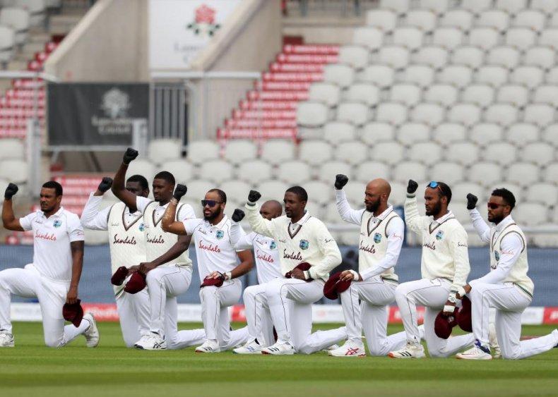 Cricket players take a knee