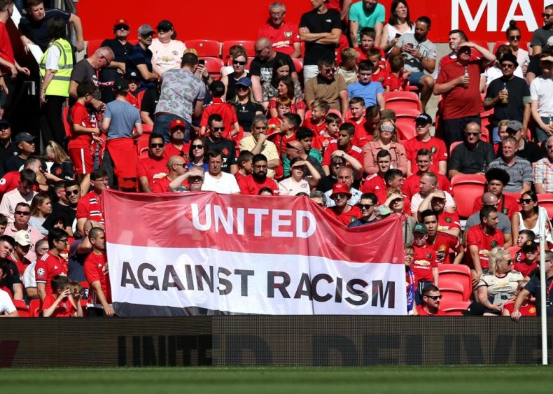 Manchester United fans display an anti-racism banner