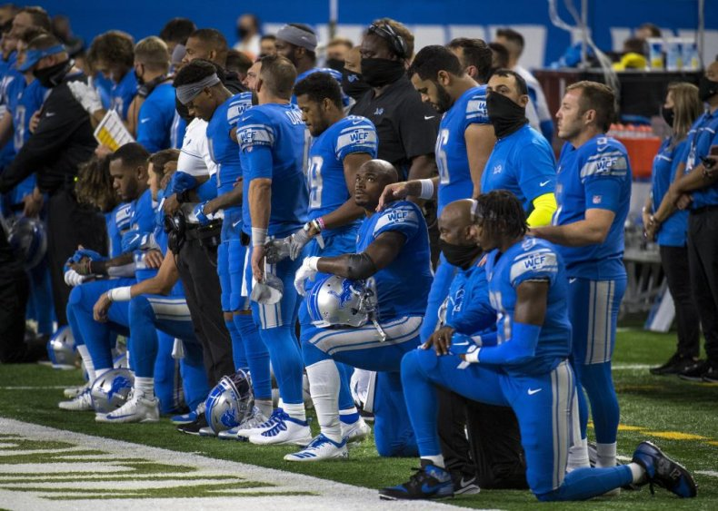 Detroit Lions players kneel during the national anthem