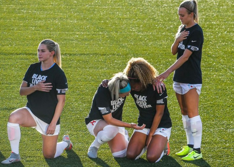Chicago Red Stars' Casey Short and teammate kneel
