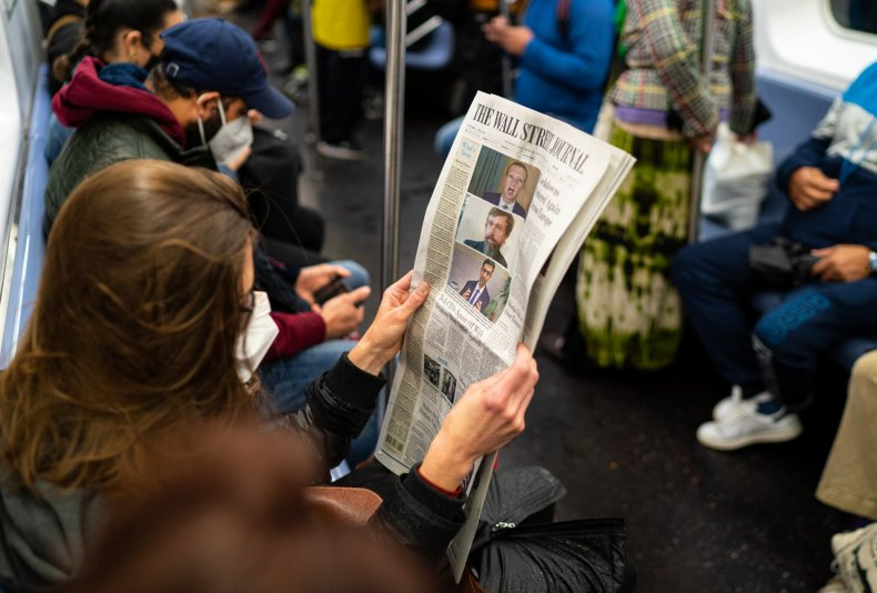 NYC passenger holds The WSJ