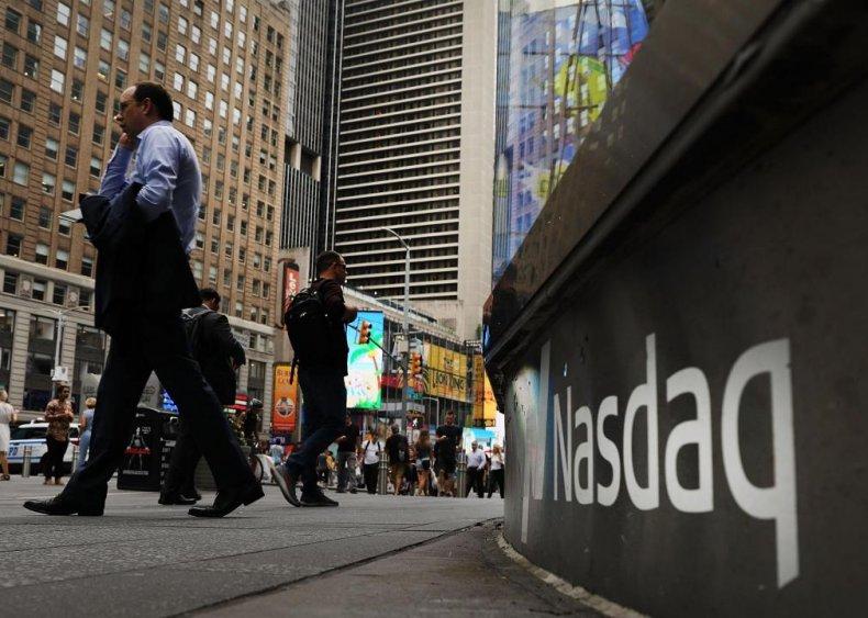 1997: Amazon IPOs on NASDAQ