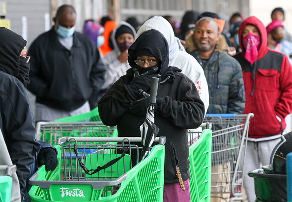 Food 'Angel' Hands Cash to Freezing Texans Waiting for Food, Then Disappears