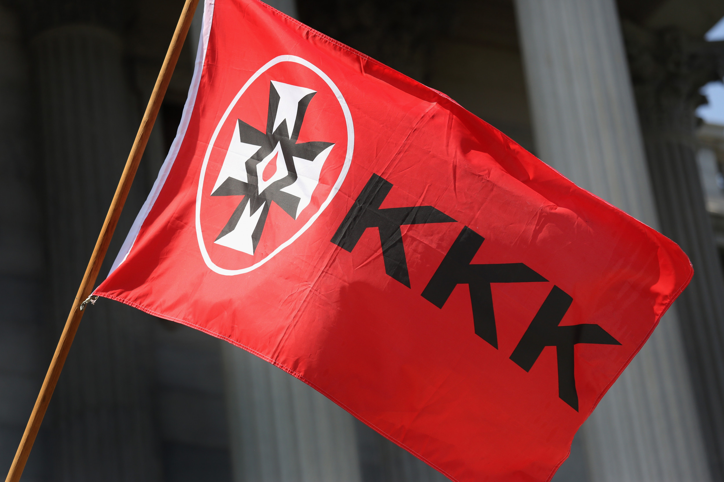 White resident hangs KKK flag in window facing Black neighbor's home