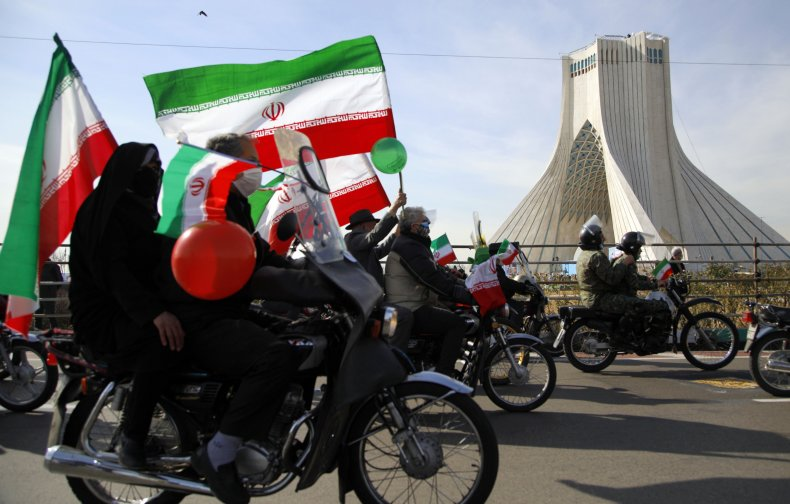 Iranians pictured in Tehran celebrating national day