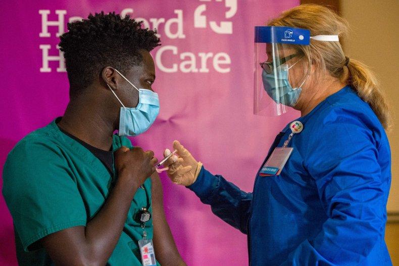 Person receiving a COVID vaccine