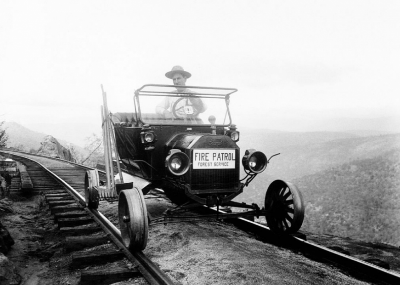 Ranger driving car on railroad