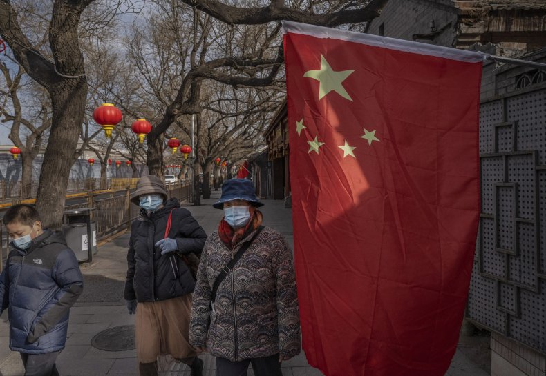 Chinese people pictured with flag in Beijing