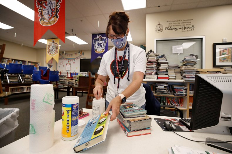 A librarian cleans books