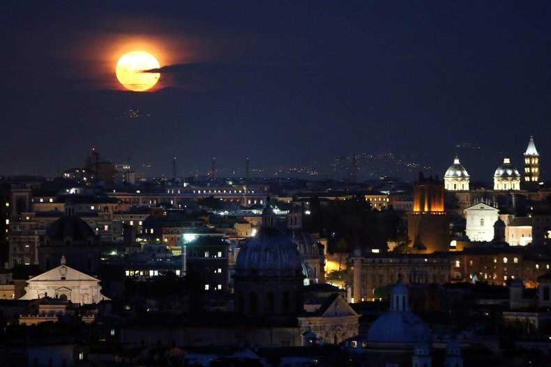 Full moon rises over Rome, Italy