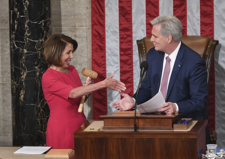 Nancy Pelosi and Kevin McCarthy shake hands