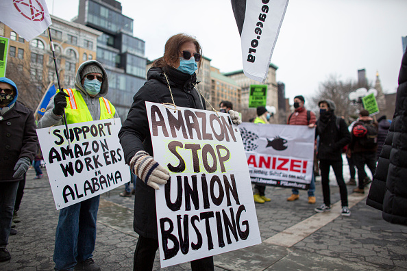 Biden warns Amazon to keep hands off union drive, draws cheers from workers