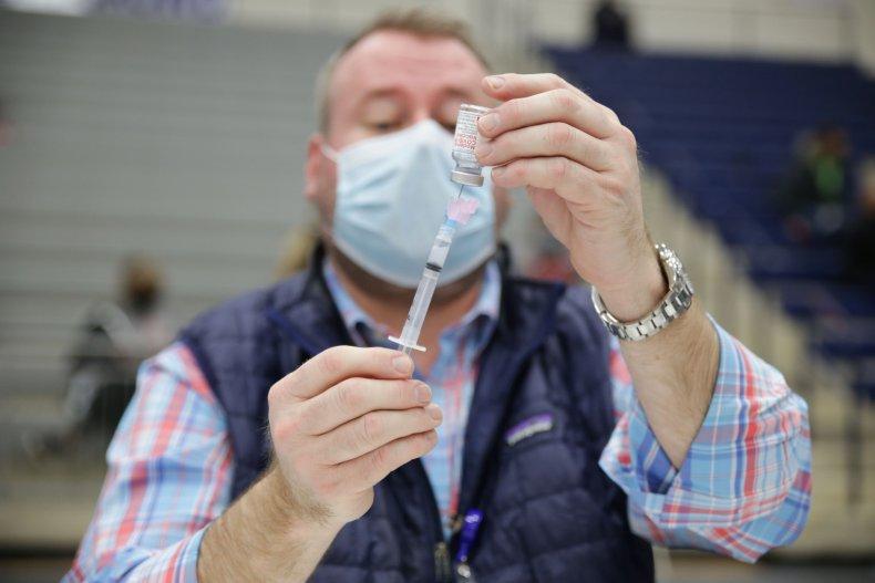 Walgreens staff prepare COVID-19 vaccines