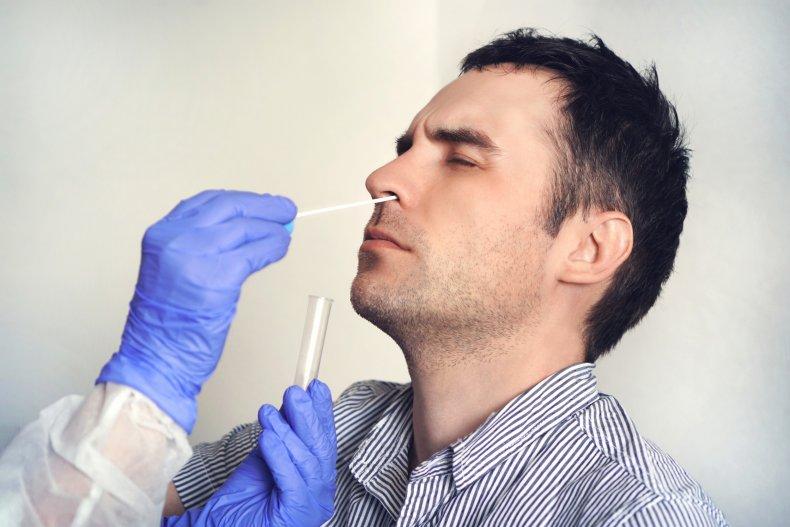 Man having nasal swab test