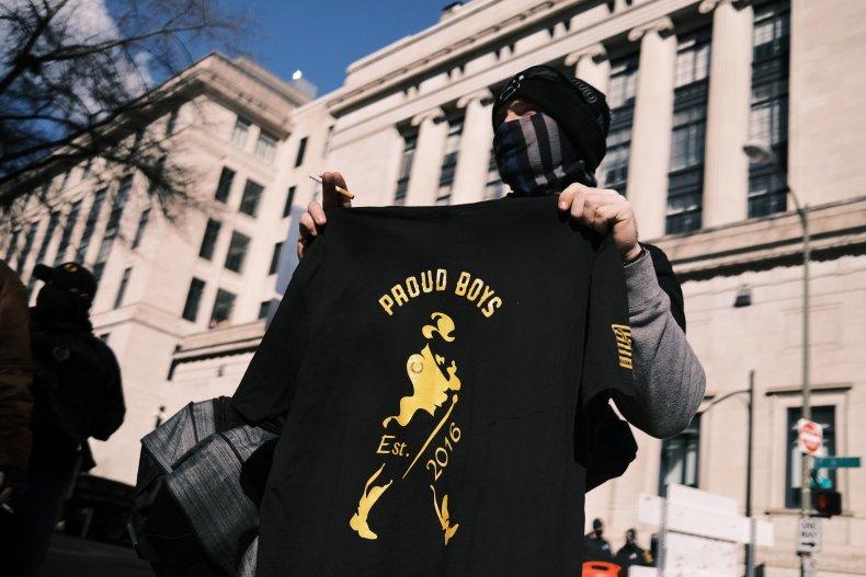 Man holding Proud Boys t-shirt in Virginia