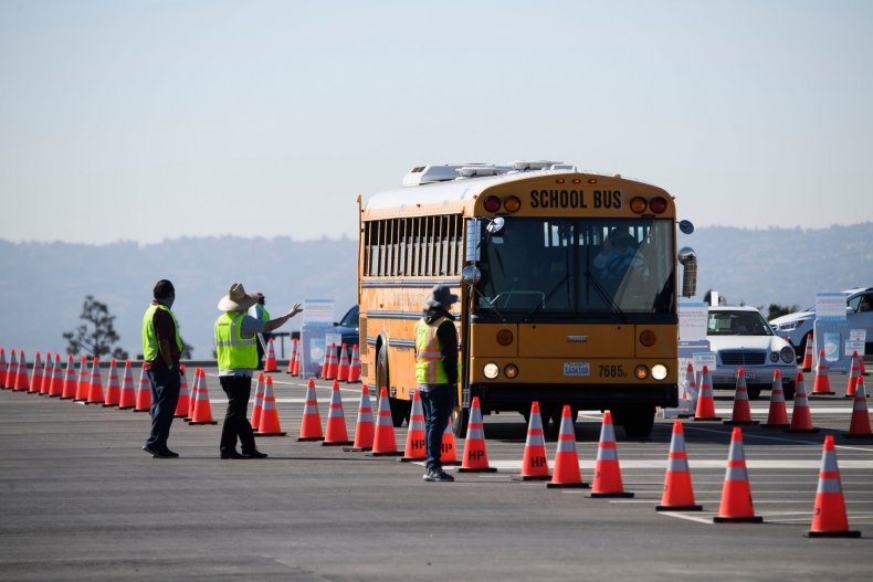 A school bus transporting education workers arrives