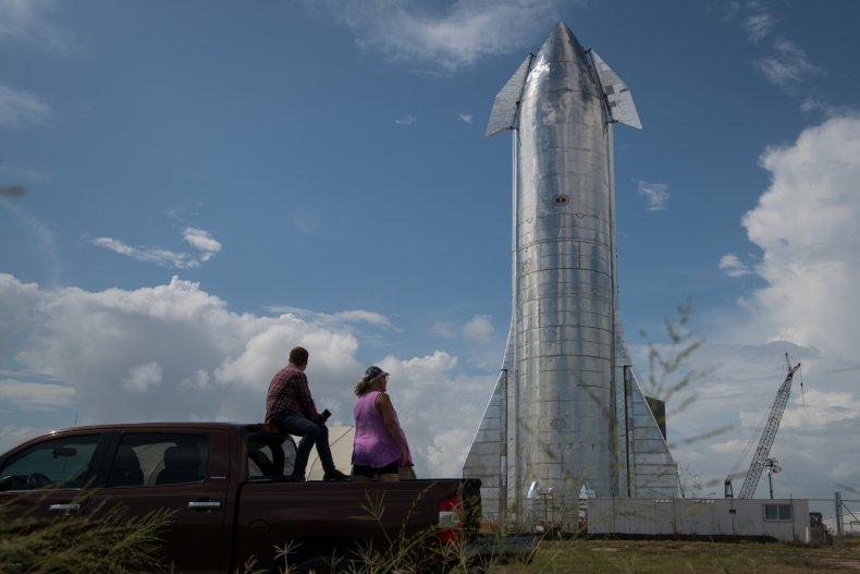 People look at Starship rocket
