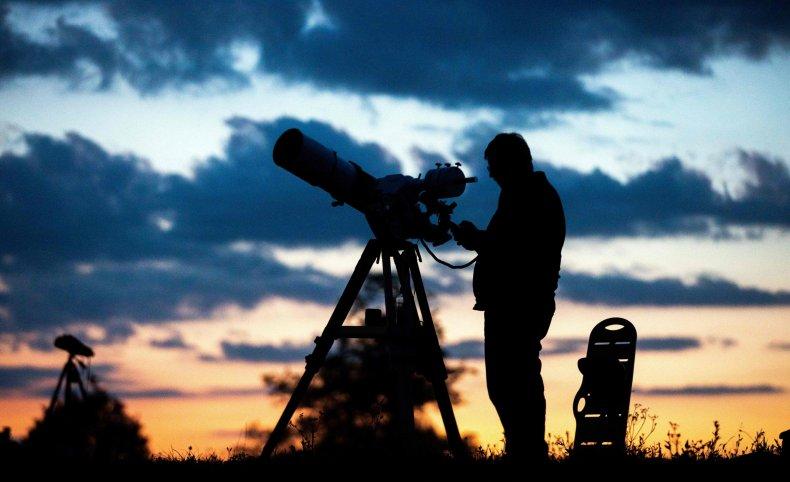 Man using telescope