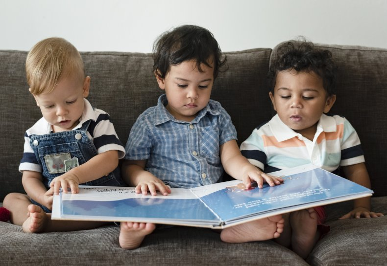 Babies reading a book