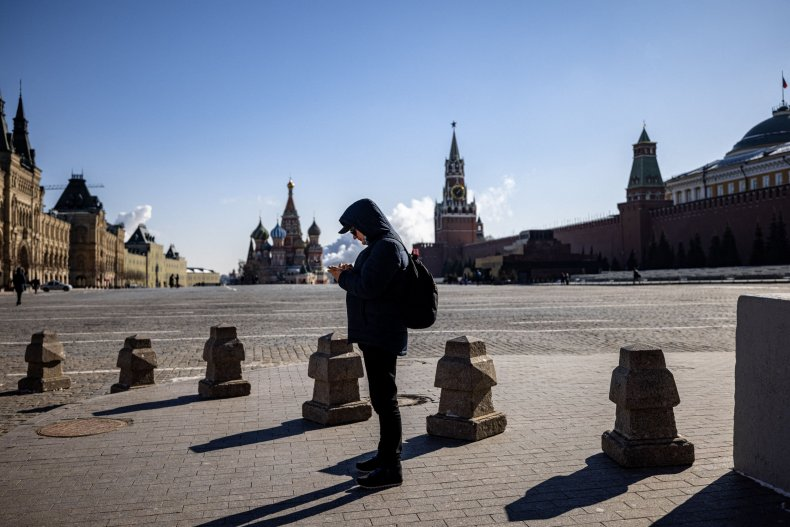 A man on his phone in RedSquare