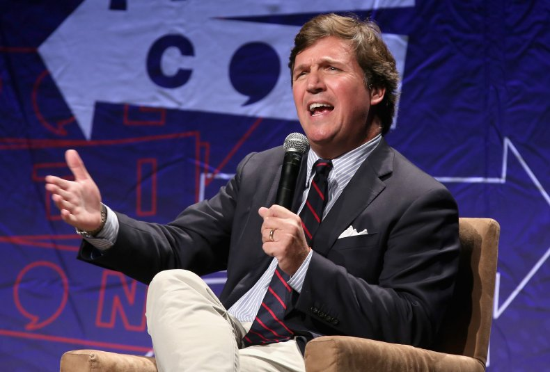 Tucker Carlson on stage in Los Angeles