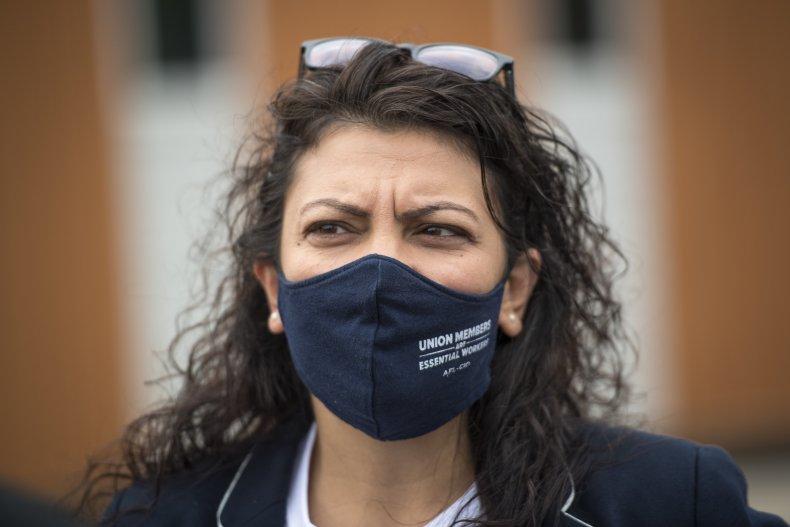 Representative Rashida Tlaib looks on before Democratic