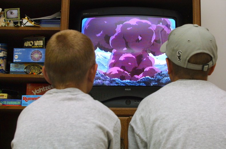 two boys watching Pokemon video